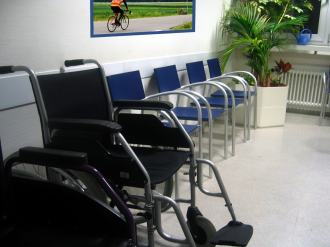 Doctors Medical Centre waiting area, with a wheelchair in seating area