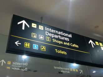 Overhead Wayfinding sign in an airport that says INTERNATIONAL DEPARTURES