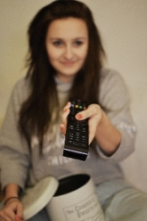 Woman hold a remote control and pointing it